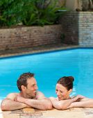stock photo of love couple  - Lovely couple  in the swimming pool - JPG