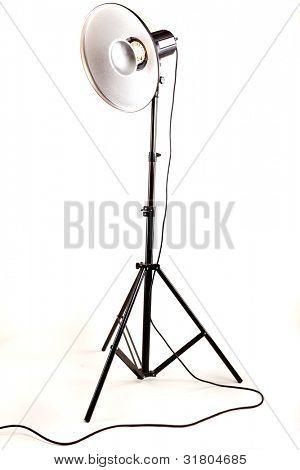 studio monoblock flash light on tripod isolated on white background
