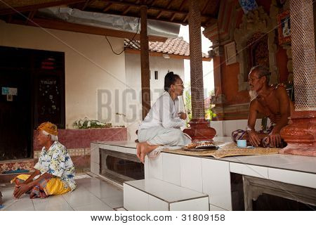 BALI, INDONESIA - MARCH 28: Hindu Brahmin befor the ceremonies of Oton - is the first ceremony for baby's on which the infant is allowed to touch the ground on March 28, 2012 on Bali, Indonesia.
