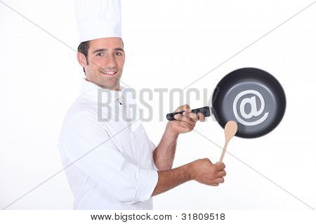 Chef holding pan in studio