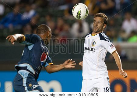 CARSON, CA. - AUG 16: Los Angeles Galaxy F Mike Magee #18 & C.D. Motagua D Sergio Mendoza #23 (L) during the CONCACAF Champions League game on Aug 16 2011 at the Home Depot Center.
