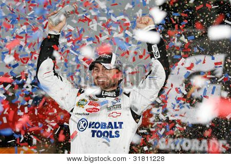 FONTANA, CA. - FEB 21: Jimmie Johnson celebrates his win of the Auto Club 500 on Feb 21 2010 at the Auto Club Speedway in Fontana, Ca.