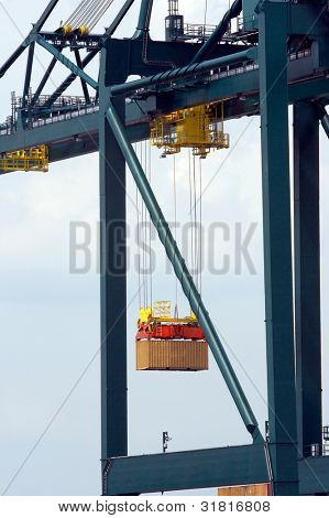 Loading of a containership in Antwerp port with containers to be shipped worldwide  - all logos and brand names removed