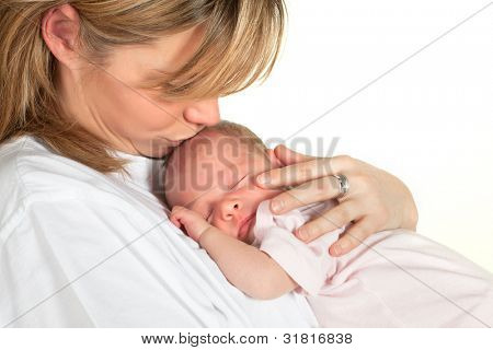 Young loving mother kissing her sleeping 18 days old baby