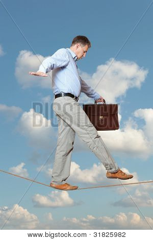 Businessman rope-walker