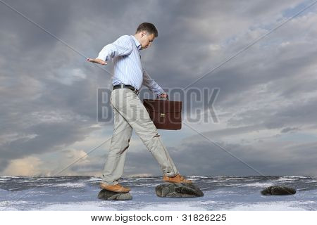The businessman walks on a bog