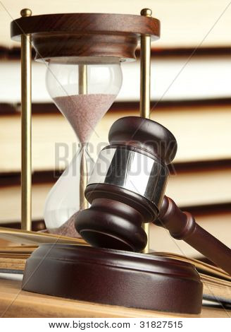 Gavel and old hourglass