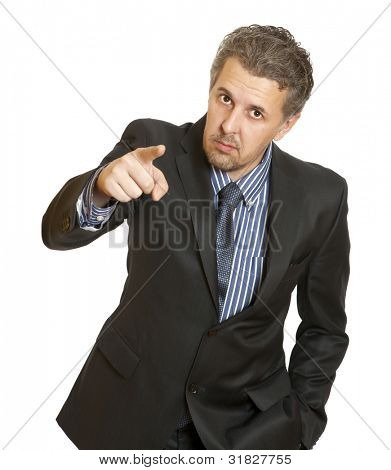 Portrait of an angry middle aged businessman in suit pointing at you isolated over white background