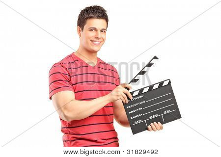 A smiling man holding a movie clap isolated on white background