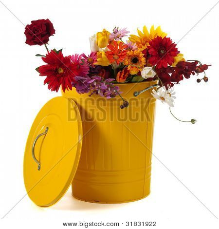 Yellow trash can filled with flowers isolated over white background