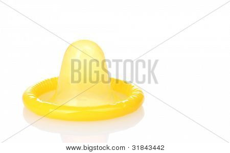 Yellow condom isolated on white