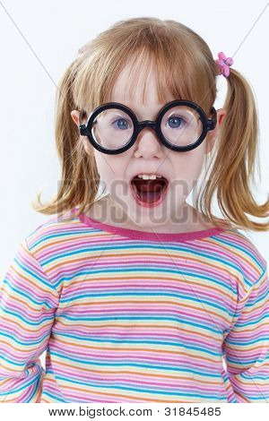 Portrait of a girl in funny glasses looking at camera
