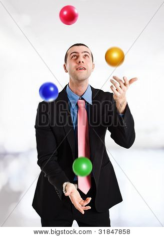 Portrait of a juggler playing with balls