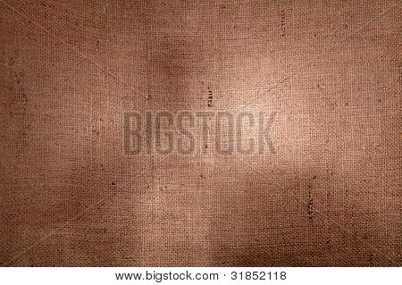 hessian burlap background with uneven light