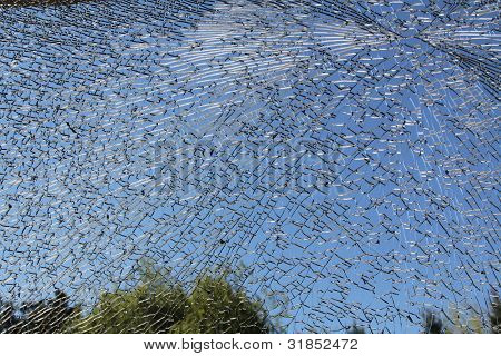 Glass Window Broken into a Million Pieces