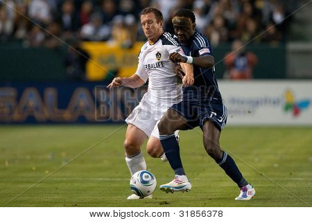 CARSON, CA - MAY 14: Los Angeles Galaxy F player Chad Barrett #11 (L) & Sporting Kansas City F player Kei Kamara #23 (R) during the MLS game on May 14,. 2011 at the Home Depot Center in Carson, CA.