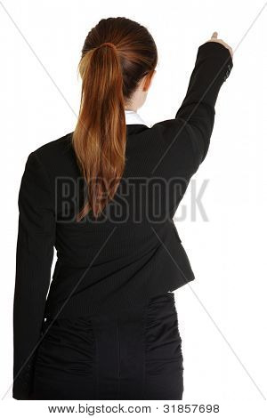 Young business woman pointing at something in her back, isolated on white background