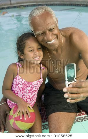 Grandfather and Granddaugther Posing for Camera Phone