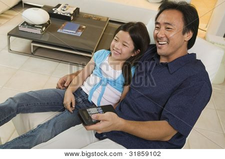 Father and Daughter Watching TV Together