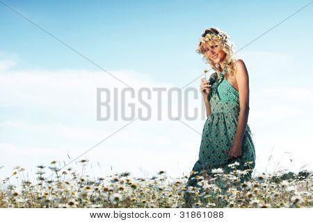 beautiful girl  in dress on the daisy flowers field
