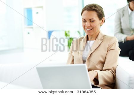 Elegant business woman working on computer