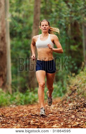 Young Woman Running on Trail