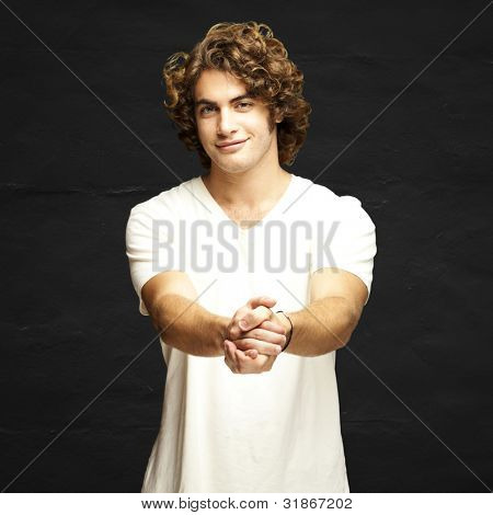 portrait of young man gesturing contract against a grunge wall