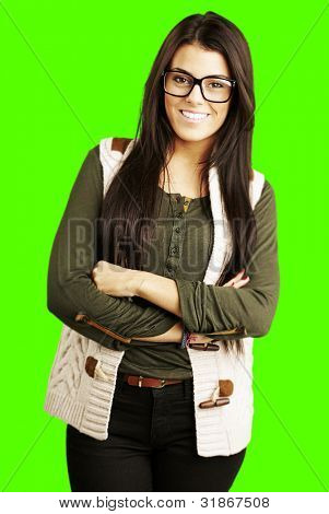 portrait of young woman standing against a removable chroma key background