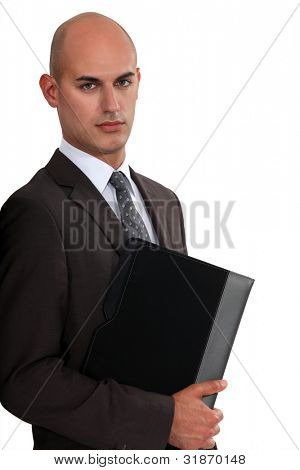 Bald businessman holding folder