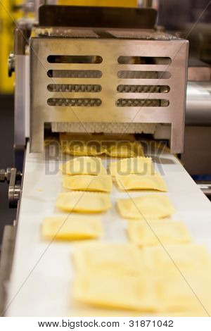 COLOGNE, GERMANY - MARCH 27 : New RS120G ravioli machine on display at the Goetz booth at the ANUGA FoodTec industry trade show in Cologne, Germany on March 27, 2012.