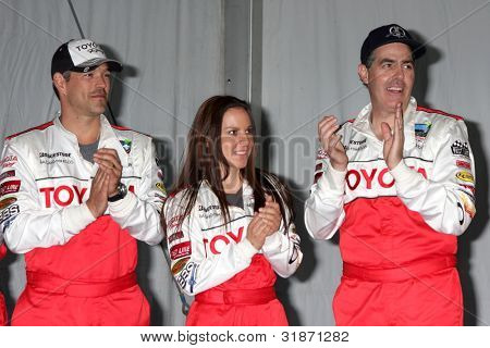 LOS ANGELES - APR 3:  Eddie Cibrian, Kate del Castillo, Adam Carolla at the 2012 Toyota Pro/Celeb Race Press Day at Toyota Long Beach Grand Prix Track on April 3, 2012 in Long Beach, CA