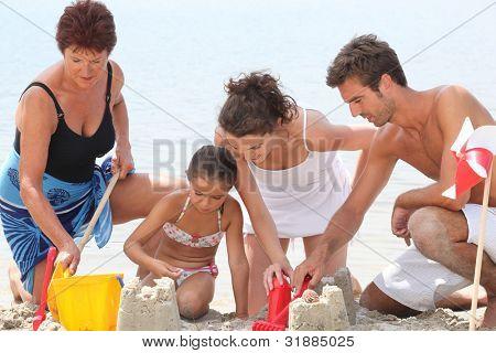 Family making sandcastle