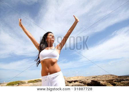 Woman stretching arms towards the sky
