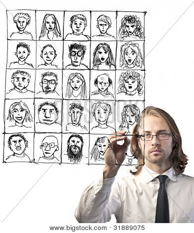 Businessman drawing a composition of portraits