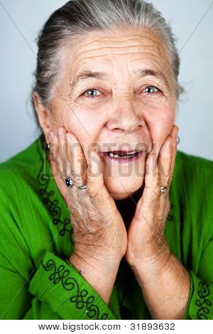 Happy and amazed old senior lady