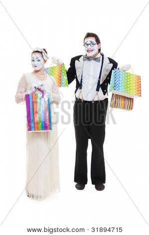 two funny mimes go shopping. isolated on white