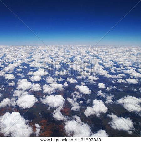 Cloudy sky background, abstract blue natural clouds, beautiful cloudscape aerial view at south African continent, Cape town from above, beauty of planet Earth