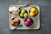 Assorted Flavors And Colors Of Gourmet Italian Ice Cream Served On Steel Table. Mango, Chocolate, Gr poster