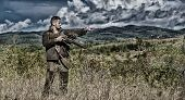 Man Hunter Aiming Rifle Nature Background. Experience And Practice Lends Success Hunting. Guy Huntin poster