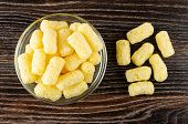 Transparent Glass Bowl With Sweet Corn Sticks, Sticks On Dark Wooden Table. Top View poster
