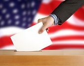 image of ballot-paper  - Hand with ballot and box on Flag of USA - JPG
