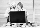 Learning With Culinary Experts. Chef And Cook Helper Gesturing Ok At Board In Cooking School. Couple poster