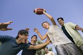 stock photo of early 20s  - Boy and Men Playing Football - JPG