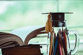 Education Knowledge Learning Study Abroad International Ideas. Graduation Hat On Glass Bottle Pencil poster