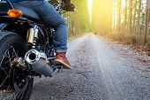 Motorcycle Driver Riding Alone On Road. Empty Road On A Motorcycle Tour Journey. Traveling, Speed An poster