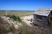 stock photo of cape-cod  - A one room cottage with a sandy trail snaking down to a private waterfront at Provincetown Massachusetts - JPG
