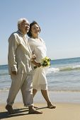 picture of early 60s  - Senior Newlyweds Walking Along Beach - JPG