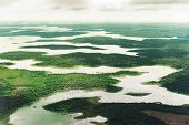 Landscape Aerial View Of Colorful Amazon Rivers, Forest, Jungle, And Fields poster