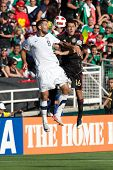 PASADENA, CA. - MAY 25: United States M Clint Dempsey #8 (L) & Mexico M Efrain Juarez #16 (R) during