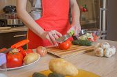 Young Woman Cooking Healthy Meal In The Kitchen. Cooking Healthy Food At Home. Woman In Kitchen Prep poster